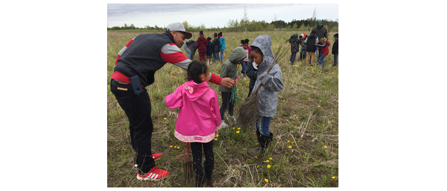 Fume extraction system supplier ULT worked with kids from the Milwaukee Public School System in planting the trees.