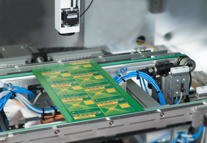 The processing area of the DIVIDOS laser depaneling system is shown.