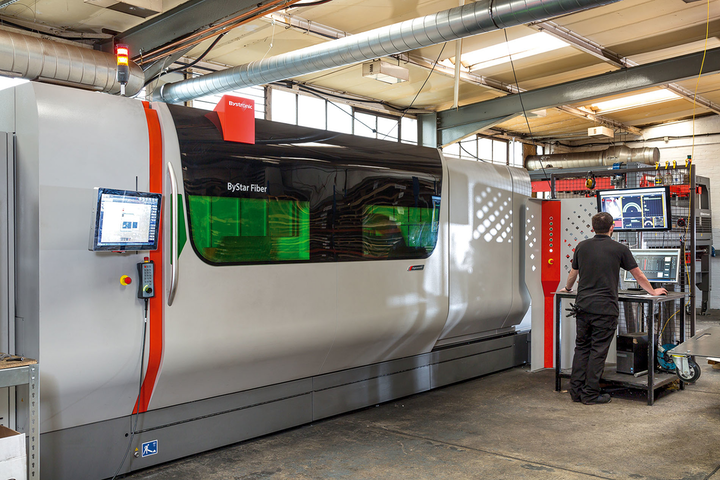 Shown is one of Laser 24's 10 kW ByStar Fiber laser cutting machines on the shop floor.