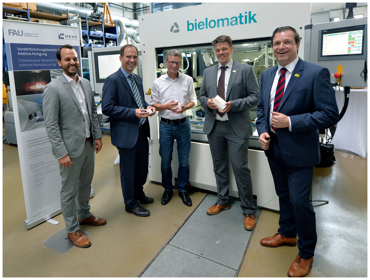 (L-R) Christian Wiesner, FIT Additive Manufacturing Group; Dietmar Drummer, FAU/LKT; Bavarian Minister of Science Bernd Sibler; and Tobias Beiss and Juergen Lochner, bielomatik, at the start of the FAB-Weld project on August 1, 2019.
