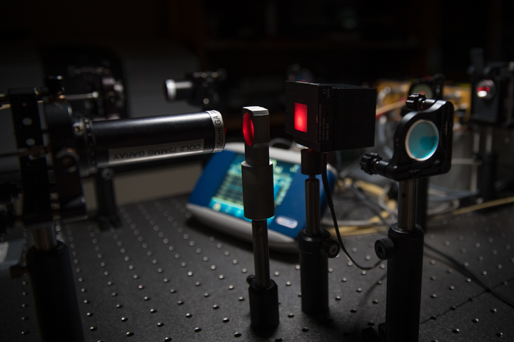 The laser setup used to test and measure the transparency of ceramic materials.