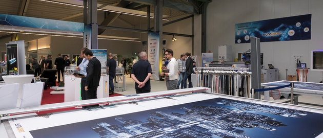 Large exhibition area with live demonstrations on nine laser systems.
