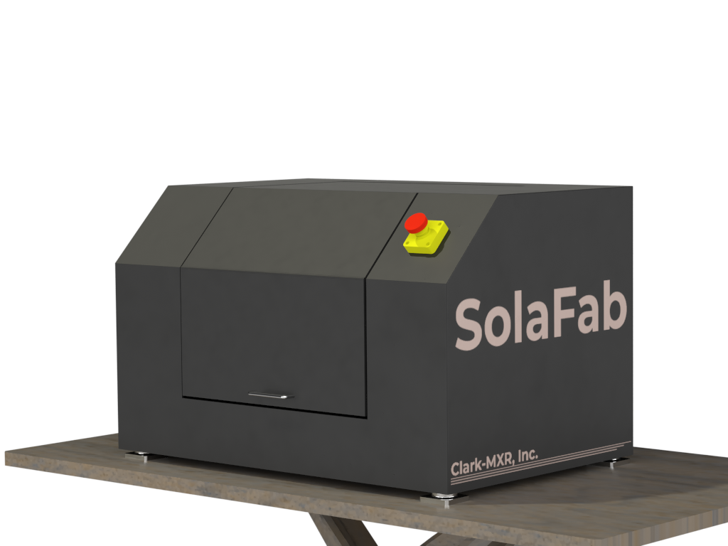 FIGURE 2. The SolaFab desktop femtosecond micromachining workstation.
